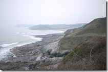 Walking over headlands on Gower Peninnsula near Mumbles, Wales