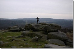 Me feeling free (and cold) atop a rocky outcrop in the Peaks District, England
