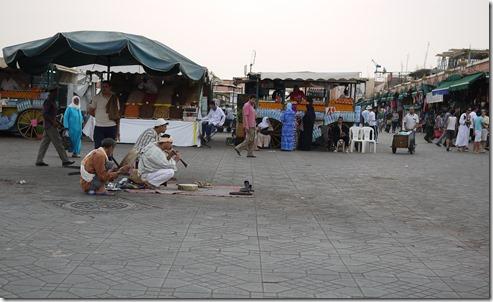 Cobra charmers in Djemaa el-Fna , Marrakech Morocco