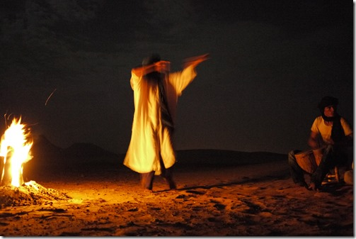 Berber song, drums and dance around the campfire in the Sahara Desert, Morocco