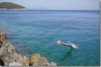 Jumping into the Adriatic Sea at Vali Lošinj on Lošinj Island, Croatia
